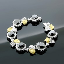White & Yellow Diamond Bangle White & Yellow Gold Prong & Pave'